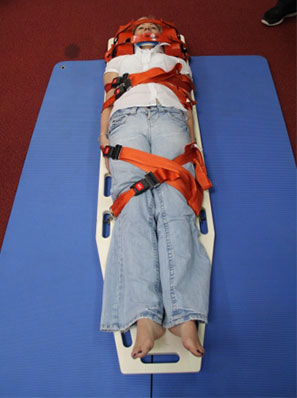 Physio Team Practicing Spinal Board Straps
